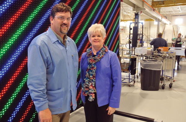 Tom Quakenbush, plant manager of the Redwood Falls branch of Daktronics, the nation's premier manufacturer of scoreboards, and Julie Rath, economic developer, Redwood Area Development Corporation